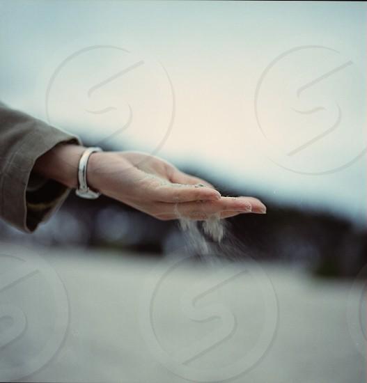 left hand dispensing white powder  photo