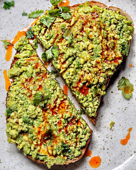 Avocado on toast with harissa infused olive oil  photo