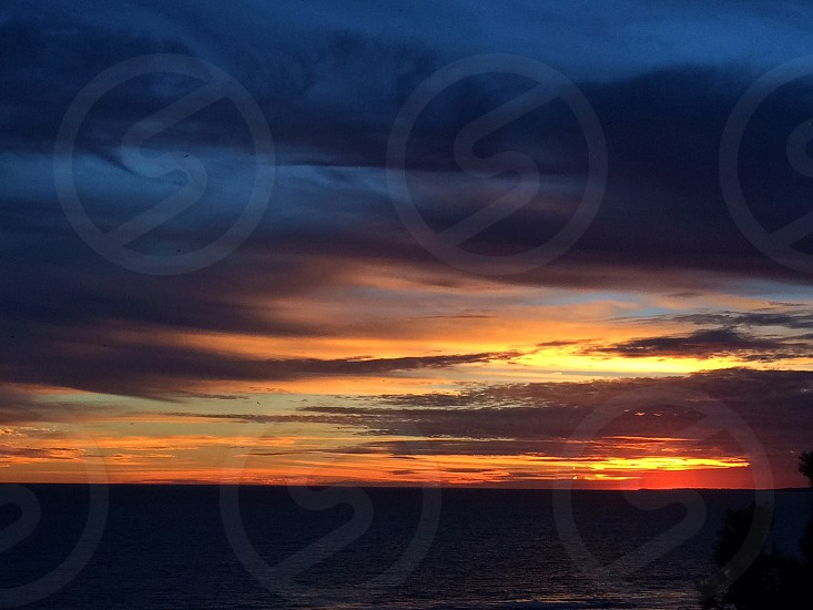 cloudy sunset over the ocean photo