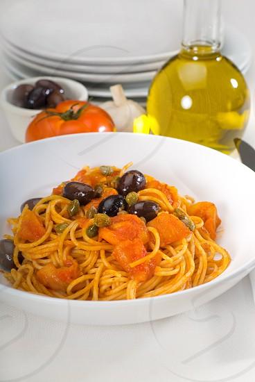 spaghetti pasta with fresh home made  puttanesca sauce photo