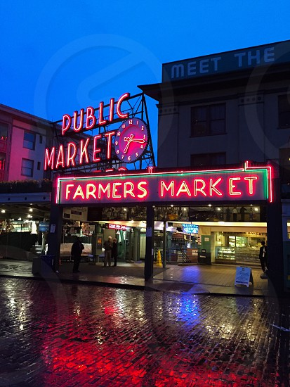 red publick market led signage beside red farmers marked led signage during nighttime photo
