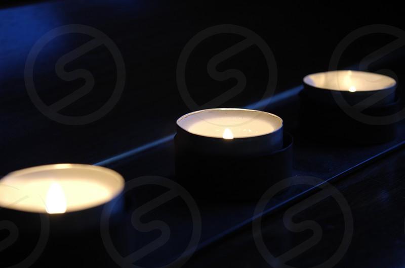 Candles Christmas light dark background  angle photo