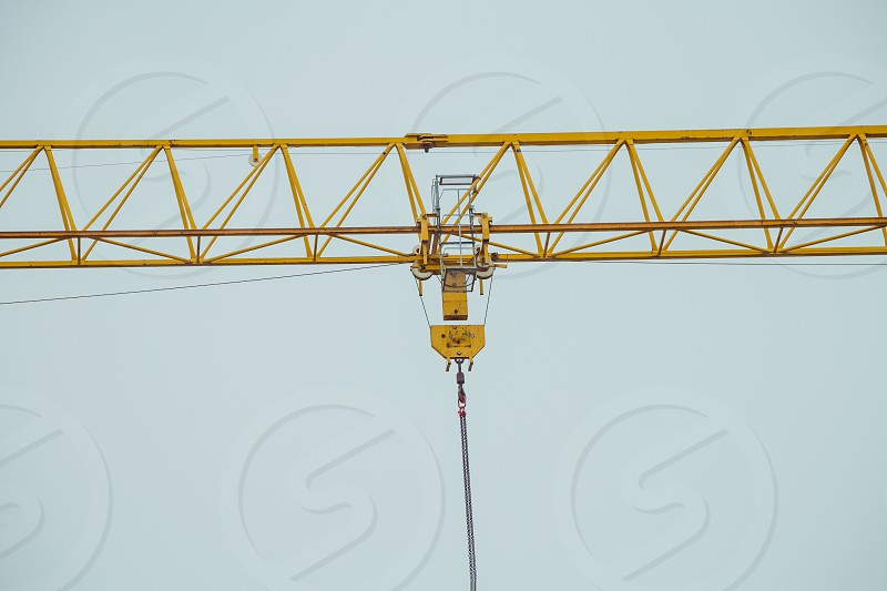 Closeup on part of yellow construction crane chain. photo