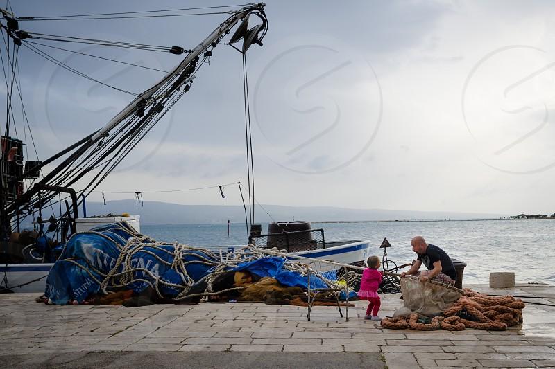 sea family fishing boat fishing net father daughter photo