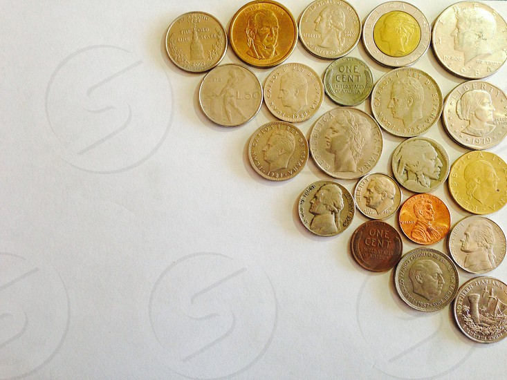 silver and gold coins photo