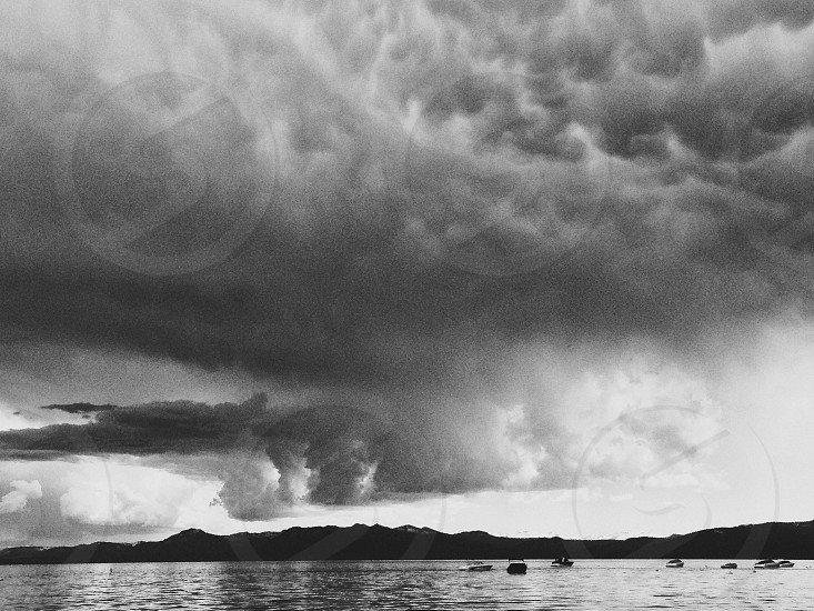 Storm clouds lake black and white photo