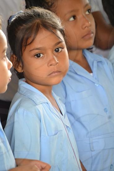 girls wearing cyan uniforms photo