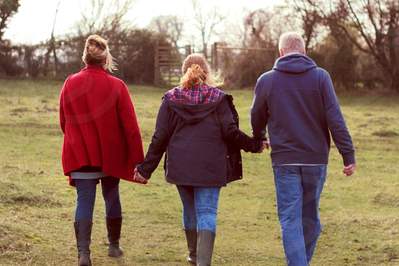 three people holding hands  photo