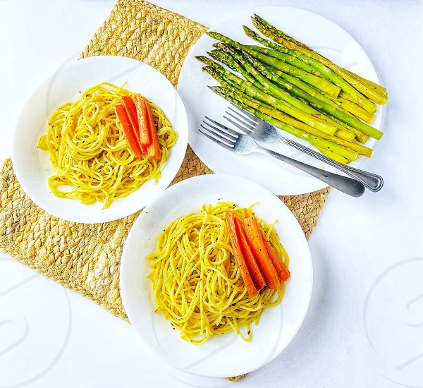 Garlic pasta with carrots and asparagus. Brunch idea. photo