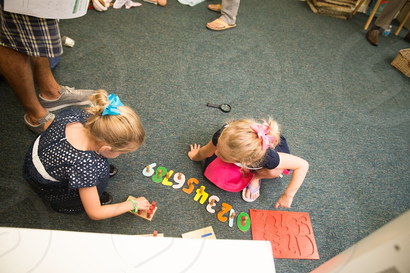 little girls playing with toy numbers photo