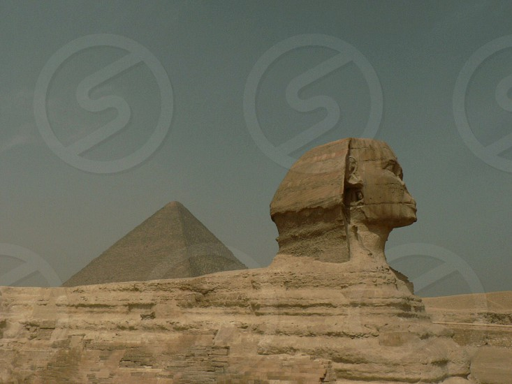 the sphinx on a cloudless blue grey sky photo