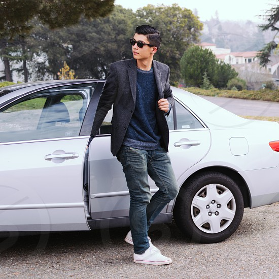 man in black coat and blue denim jeans photo