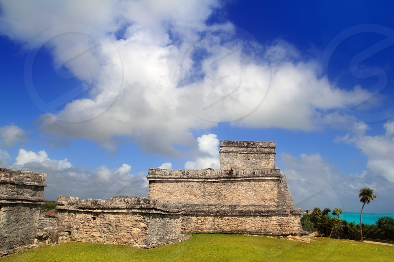 Ancient Tulum Mayan temple ruins in Mexico Quintana Roo under blue sky photo