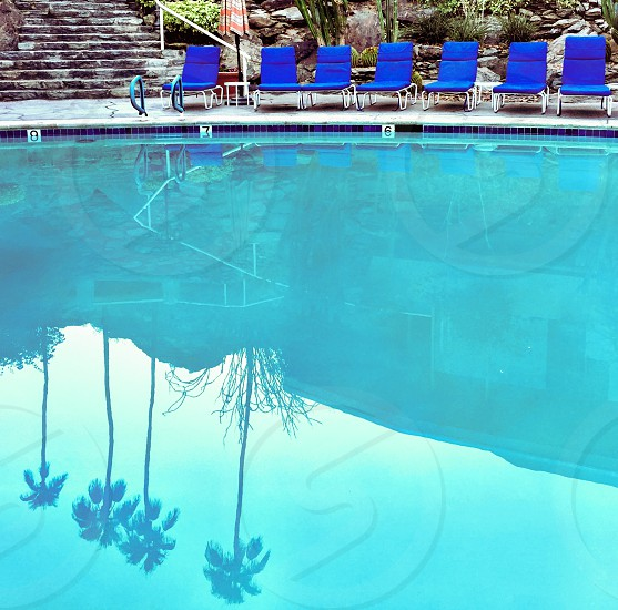 Swimming pool  and lounge chairs  photo
