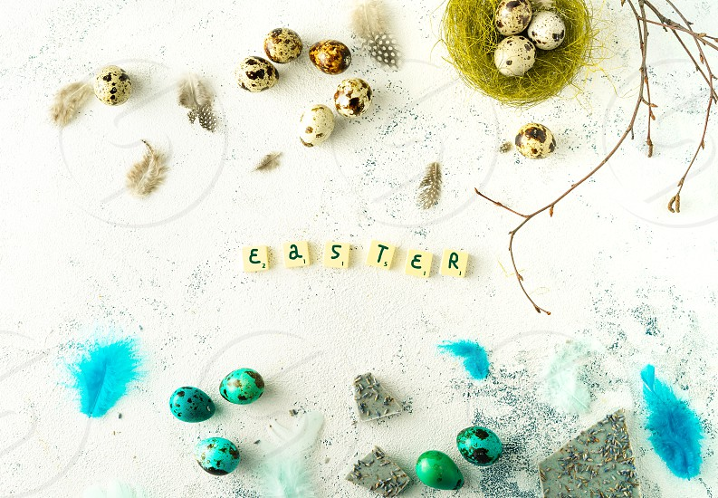Easter themed flat-lay on a white background photo