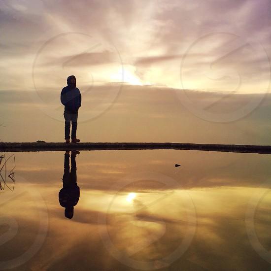 human figure against sunset photo
