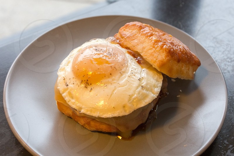 bread with sunny side-up egg on plate photo
