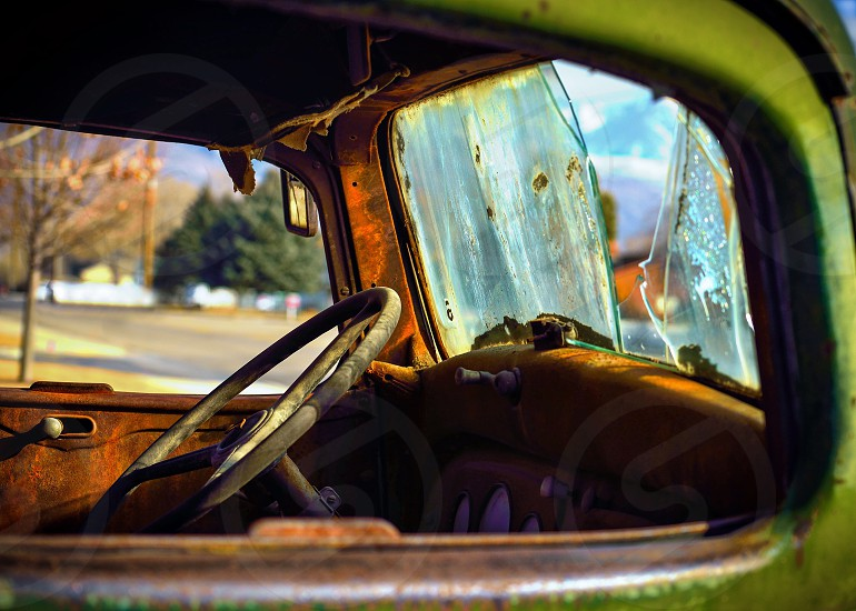 wrecked classic green car photo