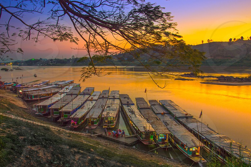 boat river water cruise Mekong Houayxay Huoeisay Houeisai Huayxai Lao Laos pdr sunset reflection ASEAN southeast Asia photo