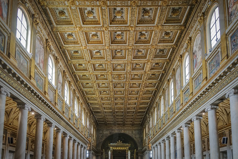 Rome Italy April 2017: interior of the Basilica of Santa Maria Maggiore in Rome with the altar the colonnade and the wooden coffered roof decorated photo