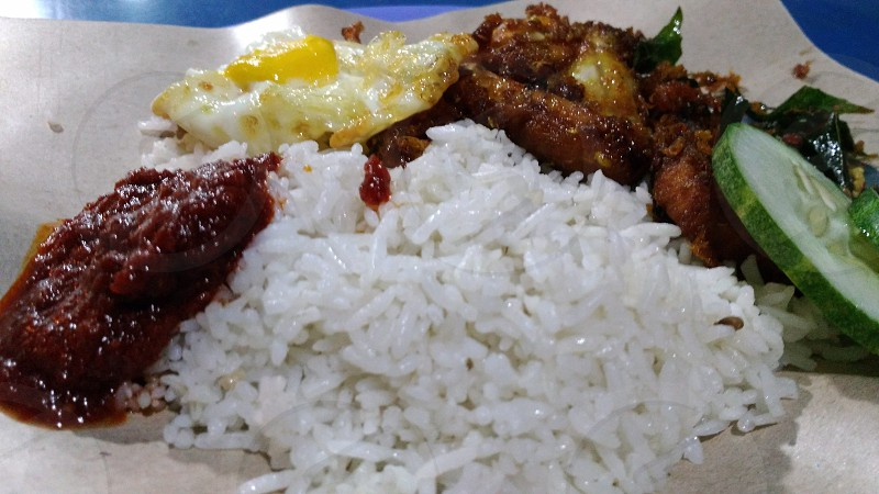 Nasi lemak for breakfast. Famous in Malaysia and Singapore. photo