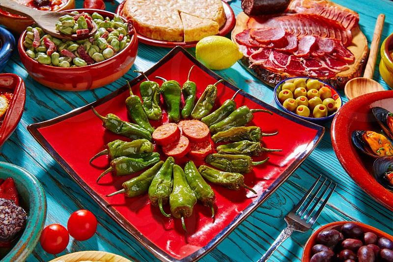 Tapas pimientos del Padron green peppers with sausage and mixed tapa photo
