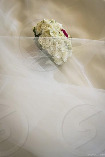 Wedding bouquet under the vail photo