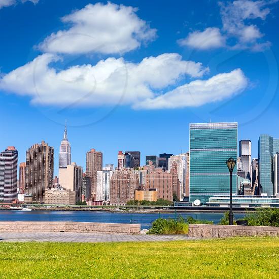 Manhattan New York sunny skyline from green park turf East River NYC USA photo