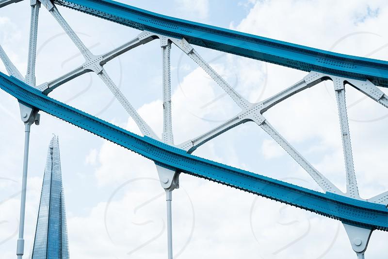 architecturedetailpatternsymmetryabstractskybuildingangularLondoncloudsThe ShardTower Bridgeframing inblocking in photo
