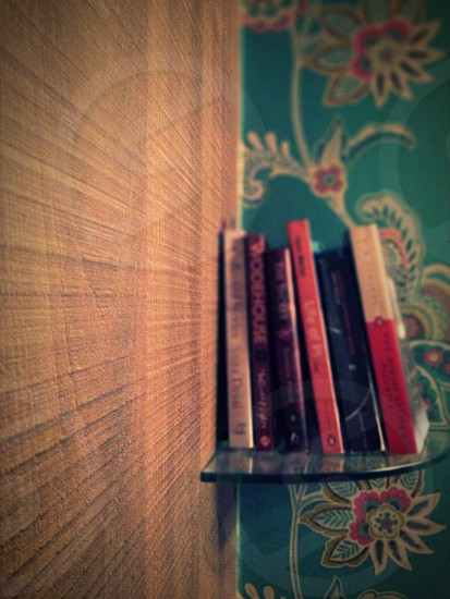 Wooden wall book shelf wood grooves  photo