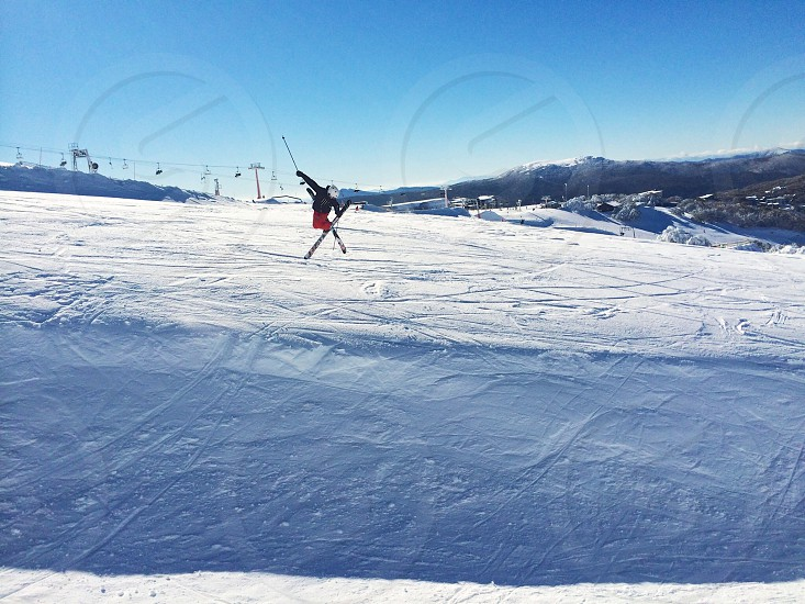 skier doing some acrobatic moves in the air photo