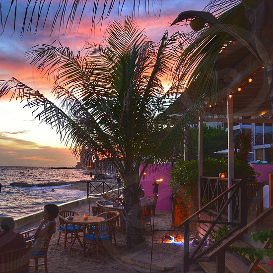 Sunset Curacao netherlands antilles happy hour caribbean enjoy happy times palmtree caribbean sunset beach ocean view caribbean sea colorful colors travel tourist Pietermaai District willemstad photo