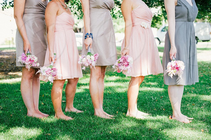 5 women holding flower bouquet  photo
