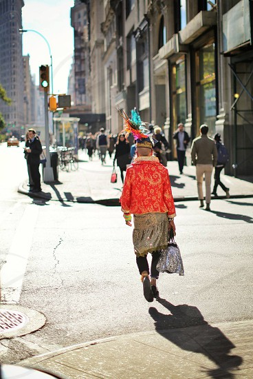 New York City vertical walking man fashion city street backlit costume high fashion  photo