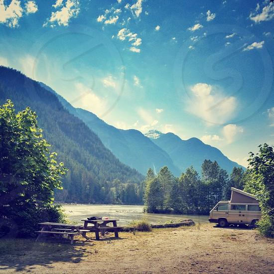 Van camper in mountain scene photo
