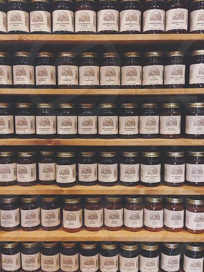 filed white labeled glass jar on shelves photo