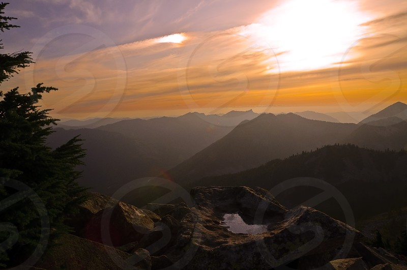 mountain top at sunset view photo