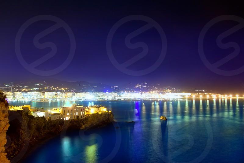 Ibiza town port blue sea night lights of Eivissa city photo