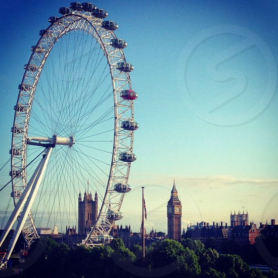 London skyline. Big Ben and the London eye.  photo