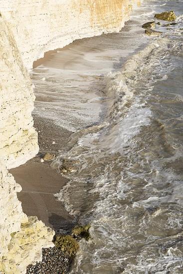sea meeting cliffs photo