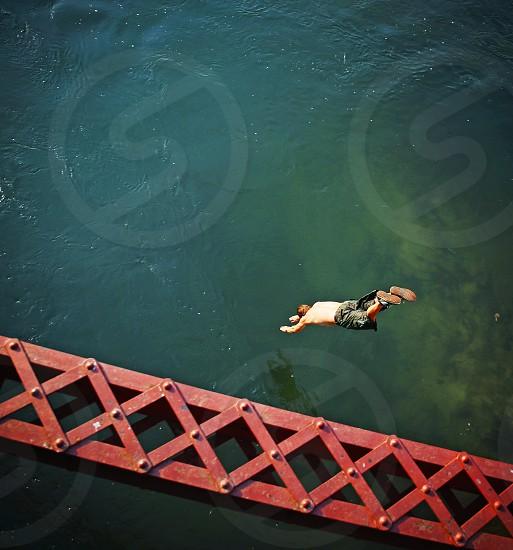 diver diving bridge water river man jumping swimming summer photo