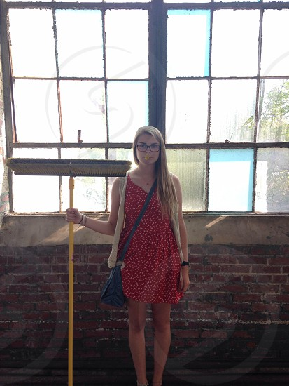 woman holding a yellow floor mop photo