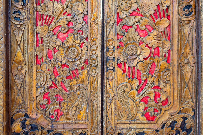 Indian inspired carved coloful golden red wooden door photo