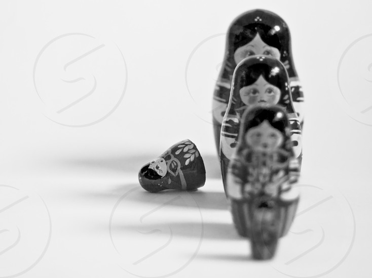 Fallen by the way side...illustrated by Russian dolls. photo