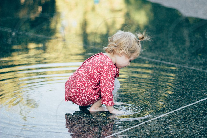 Little girl playing in the water  photo