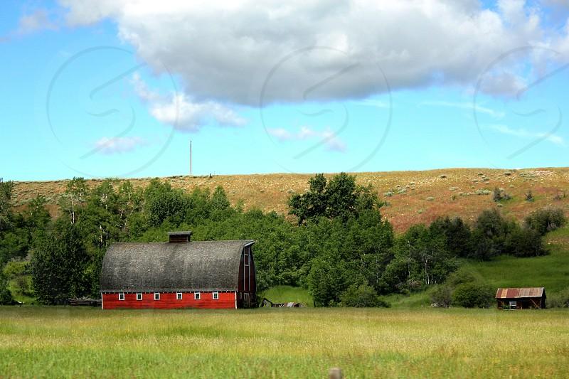 Open sky red barn photo