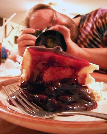 Photographer shooting cheesecake photo