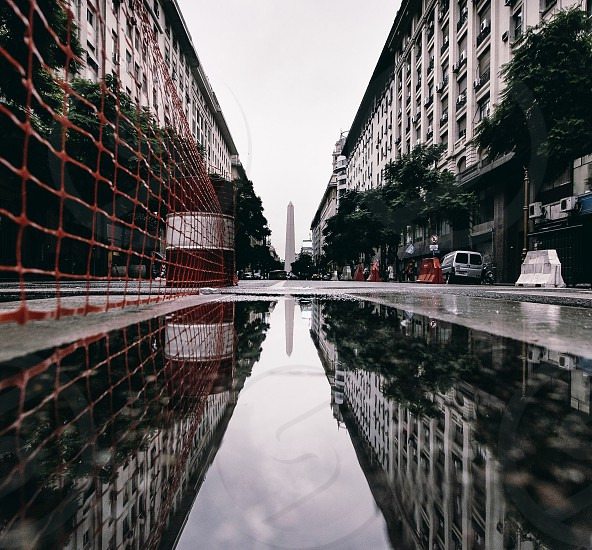 reflective photography of high rise building and tower photo
