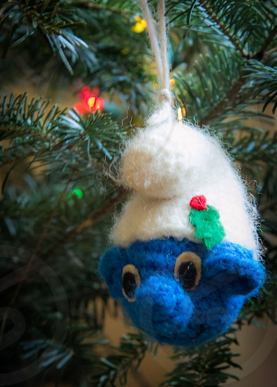 A handmade Christmas ornament in the shape of a smurf head. photo