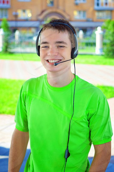 portrait of young man headset microphone; emotional smiling photo